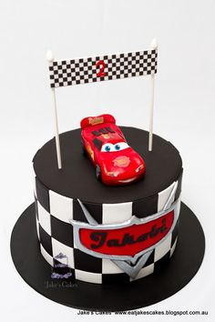 Lightning McQueen: Handmade from modelling chocolate he sits on top a rainbow layer cake on the inside. I was also lucky to have made Jakobi's first birthday cake too. Best Birthday Cake Recipe, 70th Birthday Cake, Birthday Cake Pictures, Lightning Mcqueen Birthday Cake, Lightning Mcqueen Cake, Flash Mcqueen, Steve Mcqueen, Jake Cake, Rainbow Layer Cakes