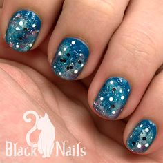 "Blue glitter galaxy nails for the fifth day ""Nature"" in the CaliforNails November nail art challenge. I think I have figured out the secret to a dimensional galaxy nail, FINALLY!"