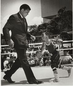 3/15/86. Bill Frakes/Miami Herald Staff. Ali spars with 7 yr old Thaddeus Ambrose.