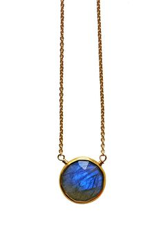 The color & blue flash in our labradorite coin necklace is spectacular! Its amazing in person, specially when it hits the light. The petite 12mm coin
