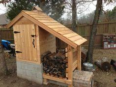 Smokehouse - Cedar smokehouse on cinder block with wood storage