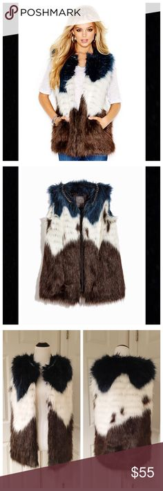 Guess multicolor faux fur vest If you like to be noticed, then the Lena vest from Guess is the perfect addition to your fall/winter wardrobe!! Featuring a multicolor print, heavy metal chain detail at neckline, 2 front pockets and front hook and eye closures. Guess Jackets & Coats Vests