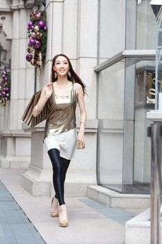 Fashionable young woman shopping in Hong Kong