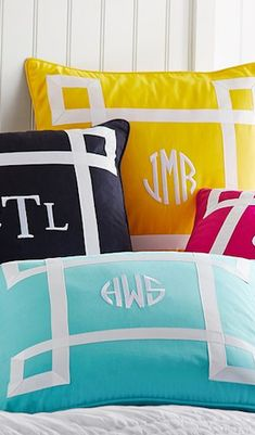 Ribbon trimmed monogram pillows