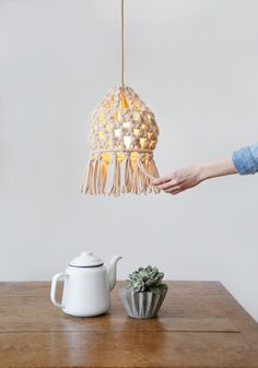The macrame trend continues its comeback with a collaboration that brings together lighting aficionados Plumen with DIY fashion brand Wool and the Gang who have designed a macrame lampshade kit you ca Macrame Design, Macrame Art, Macrame Projects, Lampshade Kits, Fabric Lampshade, Crochet Lampshade, Lamp Shades, Light Shades, Retro Lampe
