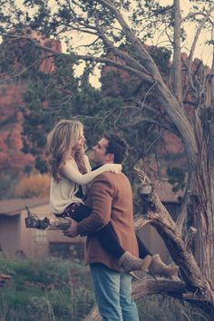 adorable. ....sitting in a tree, k-i-s-s-i-n-g. so cute. love. engagement picture.