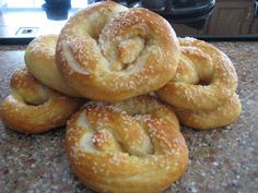Best Pretzels EVER! -- 1 1/2 cups warm water (110 to 115 degrees) - 1 tablespoon sugar - 2 teaspoons kosher salt - 1 package active yeast - 22 ounces flour (a little less than 4 1/2 cups) - 2 ounces unsalted butter (half of a stick) - 10 cups water - 2/3 cups baking soda - 1 egg beaten with about 1 tablespoon of water - Pretzel salt