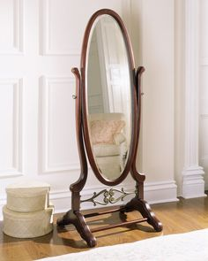 cheval mirror- a full length swinging mirror hung between two posts anchored by a cross beam