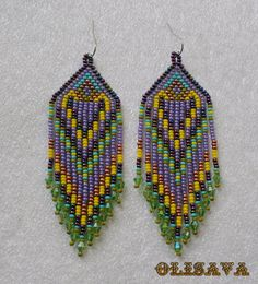 Beautiful beaded dangle peyote earrings with fringe.Native American style, Boho style. Earrings made ​​from Czech beads. Surgical Steel ear wires.. Measurements: Length - 9.5 cm (including ear wires) Width - 3 cm more earrings here http://www.etsy.com/shop/Olisava?section_id=14128476