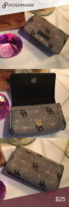 Dooney & Bourke camera case Adorable case, could be used as a phone case or clutch!! Has ring for strap, strap not included. EUC ☺️ Dooney & Bourke Bags