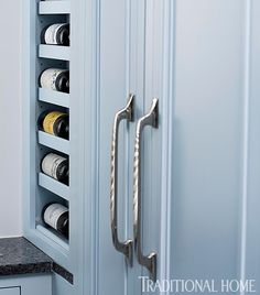 """Love the use of small pocket of space (in this instance for storage of wine with a paneled 36"""" width (Sub Zero) refrigerator beside it.) Source of hardware: Amerock  ? 'polished nickel' finish."""