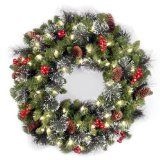 National Tree 24-Inch Crestwood Spruce Wreath with Silver Bristle/Cones/Red Berries/Glitter/50 Clear Lights - affiliate links