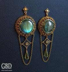 love the labradorite cabs, has a vintage look to them, her work amazes me!!