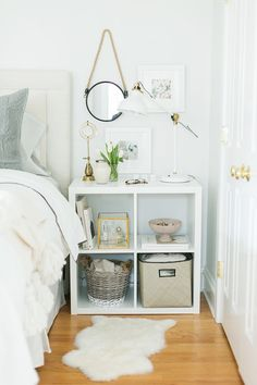 Your bedside table doesn't have to literally be a table—a small shelf is a great alternative, particularly since all of your books will be within arm's reach for a bedtime read.