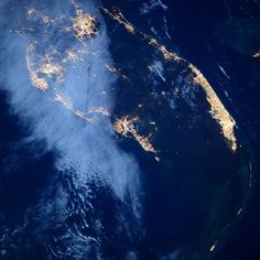 Florida under full moon by AstroButch. Thin Gulf cloud veil, Miami shines bright, and the keys trail into night Earth View, Spaceship Earth, International Space Station, Space Photos, Earth From Space, Aerial View, Planet Earth, Full Moon, Mother Earth