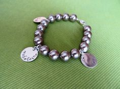 pearl bracelet with charms