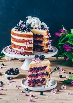 This vegan Lemon Blueberry Cake is soft, moist, and totally delicious! It is layered with a creamy lemon frosting and a sweet blueberry filling, making it a perfect dessert for Easter or anytime you want a fruity layer cake! Bolo Vegan, Cake Vegan, Vegan Desserts, Vegan Vanilla Cake, Plated Desserts, Food Cakes, Dessert Parfait, Cake Recipes, Dessert Recipes