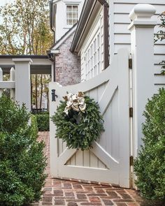 "@flowermagazine shared a photo on Instagram: ""A wreathed gate at interior designer Jane Schwab's home in Charlotte, North Carolina, sets the mood. Story at link in bio. Photography by…"" • Dec 6, 2020 at 1:01pm UTC"