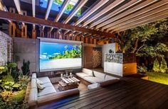 Outdoor Home Theater With Modern Seats And Low Deck