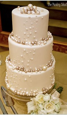 Elegant Wedding Cake with Pearls Photo make the pearls with chocolate covered cheesecake. I love pearls for weddings. So classy and elegant!