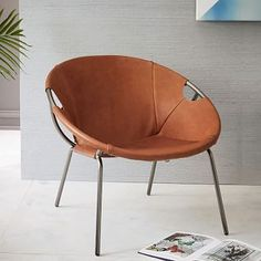 smaller more sculptural chair- four of these around a table could be a fun place to play a game or hang out