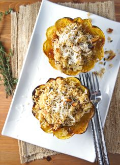 Quinoa Stuffed Acorn Squash; I added jalapeño sausage, celery, mushrooms, carrots  & red onions. Very yummy!!