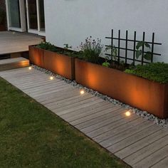 a neutral wooden garden path with a perfectly manicured lawn on one side and met., a neutral wooden garden path with a perfectly manicured lawn on one side and metal garden planters placed on pebbles on the other. Wooden Garden Planters, Diy Planters, Terrace Garden, Garden Paths, Landscape Design, Garden Design, Deck Design, Casa Patio, Garden Cottage