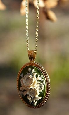 green and ivory flower pendant