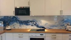 Recently we completed a splashback with a striking digital image printed on the back of the glass. We were able to use an image sourced and provided by the customer, which was then scaled and measured to suit the space. Calming blue was a nice. Kitchen Backsplash, Kitchen Countertops, Printed Glass Splashbacks, Glass Printing, Kitchen Wallpaper, Glass Kitchen, Home Kitchens, Modern Kitchens, Interior Design Kitchen