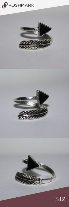 Beautiful NWOT Bypass feather and arrow ring Beautiful ring NWOT Stunning Feather with black enamel arrow. size 7.5  but could go up or down a size Buy from me with confidence! I have sold over 500 items with a 5 star rating! If you have any questions, do not hesitate to ask.  Looking at a few things in my shop? Put a bundle together, comment on an item that you are ready to check out and let me send you an even better offer!  Thank you for visiting :) Free gifts with every purchase! Jewelry…