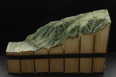 Paysages sculptés dans des livre par Guy Laramee