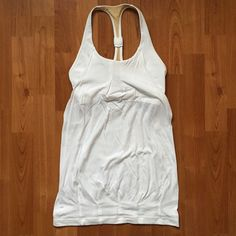 """LULULEMON White Practice Freely Yoga Workout Tank Lululemon Athletica white Practice Freely Tank Top.  ❥ Excellent condition. Minimal wash wear. No pilling, rips or stains.   ❣ No trades. No PayPal. No holds. ❣ ❣ For offers, use the """"Offer"""" button below. ❣ lululemon athletica Tops"""