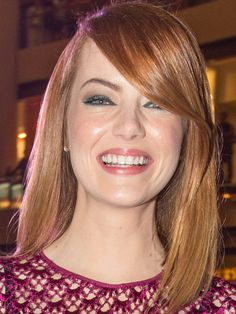 Emma Stone: Side-parted straight hair with green liner http://beautyeditor.ca/2014/04/22/emma-stone-hair-and-makeup/