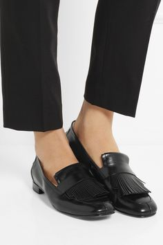 Fringe benefit: You look like a badass. Tod's | Fringed leather loafers | NET-A-PORTER.COM