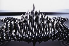 Sachiko Kodama: 'Ferrofluids appear as black fluid and are made by dissolving nanoscale ferromagnetic particles in a solvent such as water or oil. They remain strongly magnetic even in a fluid condition which makes them more flexible than iron sand.'