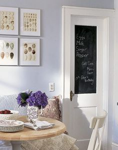 I am in search of a door where I can do this.  I've already allocated a large cork board to my pantry door because that works for me and mine.  I have thought about painting a framed type cabinet door but the surface is very textured.  Maybe I could fit it with glass or something else that is very smooth?  {Kitchen Color - Paint and Color Ideas for Kitchens - Country Living}