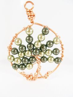 Green Crystal Pearl Copper Tree of Life Necklace. $30.00, via Etsy.