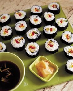 """""""Vegetable Sushi"""" Nori and tangy sushi rice are rolled around julienned carrot, red bell pepper, celery, and scallion to make this colorful, fun-to-eat veggie sushi."""