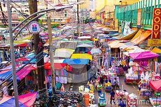 MANILA, PHILIPPINES - September Top view of the vibrant crowded market in Chinatown in Manila, the capital of the Philippines. Tents and trays of street vendors of various goods on outdoors Street Vendor, Manila Philippines, Future Travel, Top View, Asia Travel, Times Square, Places To Visit, Tents, September