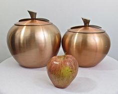These mid century vintage 1950's anodized aluminum copper apple canisters are charming!