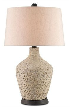FREE SHIPPING IN THE US. USE CODE LOVE10OFF FOR 10% OFF YOUR ENTIRE PURCHASE.  Strikingly reminiscent of Old World relics, the Annesville Table Lamp incorporates a unique hand-throwing and molding process to replicate the look of an authentic artifact. Eggshell terracotta, featuring a traditional geometric motif, is painstakingly wrapped around a wooden base and finished with Spanish Gilt accents.  PRODUCT NAME: Annesville Table Lamp DIMENSIONS: 31h SHADES: Beige Poplin 17x19x11.5