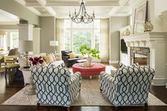 Love the colors; neutral but colorful.  Pop of pink in the ottoman - dark, graphic print on the club chairs.