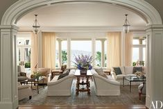 Centering the living room are twin sofas by Anthony LawrenceBelfair upholstered in a Nina Campbell chenille