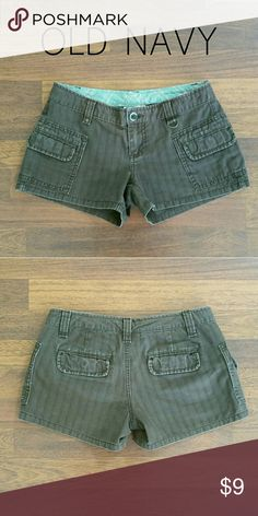 OLD NAVY Brown shorts Size 0 Great pair of Brown low rise shorts by OLD NAVY in juniors size 0! Front and rear pockets with fun hidden button closures. Pin stripe accents are spaced vertically along the fabric. These are a summertime must-have! 100% cotton. Old Navy Shorts
