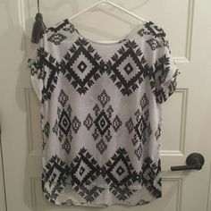 Aztec print shirt Aztec print, high low shirt ( shorter in front, long in back) Charming Charlie Tops Tees - Short Sleeve