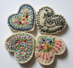 Embroidered and embellished felt hearts. Small is good! Think of possible uses.
