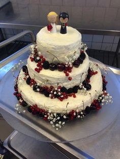 Wedding cake with chocolate, berry mousse and lemon creme cheese frosting