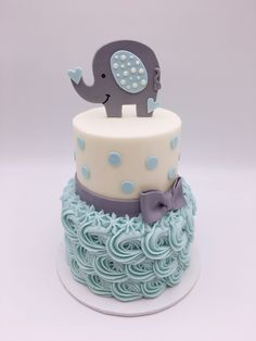 2 Tier Blue Rosette Baby Shower Cake with Polka Dots and Elephant by 3 Sweet Girls Cakery! Torta Baby Shower, Baby Shower Sweets, Baby Shower Cakes For Boys, Baby Boy Cakes, Baby Shower Fun, Baby Showers, Elephant Baby Shower Cake, Elephant Cakes, Baby Shower Cake Designs