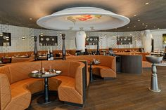 Marcel Wanders has designed the interiors of the 245 suite Kameha Grand Zurich. When designing the spaces, Wanders was inspired by a variety of Swiss cultural elements, such as chocolate-patterned wall paneling, mini-bars modeled after bank vaults, and lamps that resemble over-sized cowbells.