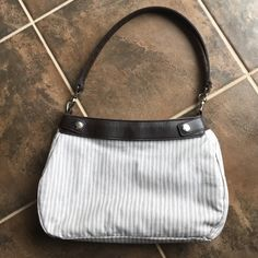 Thirty-One skirt purse  Tan strip purse with a dark brown strap. Very clean inside and out. Zipper closure. Thirty-One Bags Shoulder Bags